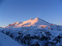 Elbrus in the winter evening. Mount Elbrus is an ancient extinct volcano and the highest mountain in Europe. Its height - 5642 m. view from mount Cheget stock photo