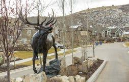 Elch-Statut mit Rudolph Red Nose Lizenzfreies Stockbild