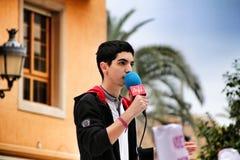 Boy speaking in public against gender-based violence demonstration. Elche, Alicante, Spain- November 24, 2018: Boy speaking in public against gender-based stock photography