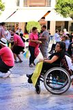 People participating in activities for the world day of cerebral palsy stock images