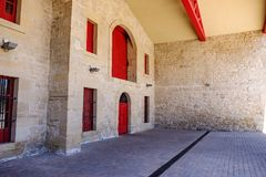 Elciego, Álava, Spain. April 23, 2018: Entrance to the stone cellars where the Rioja wine aged Marqués de Riscal aged, with its. Typical red doors stock photos