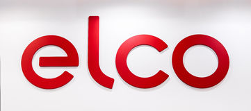 Elco company logo. Plastic red letters on the white wall Stock Image