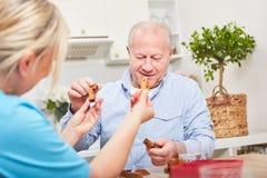 Eldcare assistance with senior man. Eldcare assistance with senior men with dementia stock images