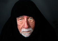 Elder Arab Sheik with a somber expression Stock Photos