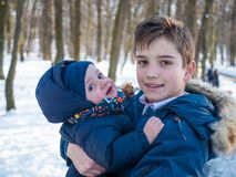 Two adorable brothers in winter park royalty free stock photos