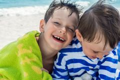Elder brother shows love to younger smiling happy royalty free stock image
