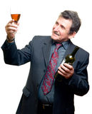 Elder businessman with glass of red wine. Isolated on white Royalty Free Stock Photos