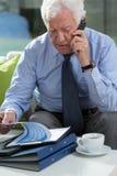 Elder businessman talking on phone Royalty Free Stock Photography
