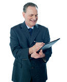 Elder confident man making business notes Stock Photo