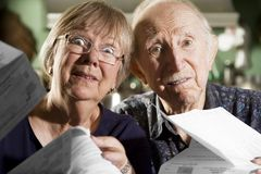 Elder Couple with Bills Stock Images