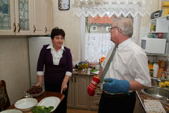 Elder couple cooking in kitchen Stock Image