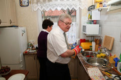 Elder couple cooking in kitchen Royalty Free Stock Photo
