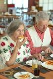 Elder couple eating Stock Image