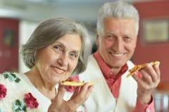 Elder couple eating Royalty Free Stock Photo