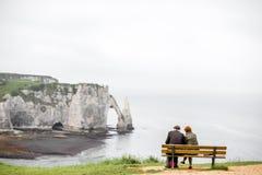 Elder couple enjoying view on the rocky coastline Stock Photography