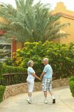 Elder couple in exotic garden Royalty Free Stock Photography