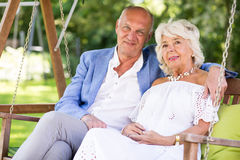 Elder couple in the garden Royalty Free Stock Photography