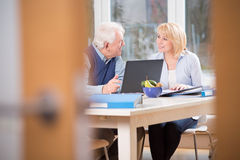 Elder couple in home office Stock Image