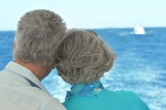 Elder couple looking a sea together Stock Photo