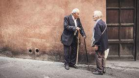 Elder couple outdoors with canes Stock Images