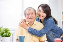Elder father and young daughter stock photography