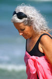 Elder female at the beach Royalty Free Stock Photo