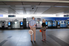 Elder foreign waits for skytrain at Siam Station Royalty Free Stock Photo