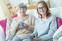 Elder friends drinking coffee Royalty Free Stock Photography