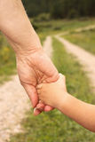 Elder hand holding youth hand Royalty Free Stock Photo