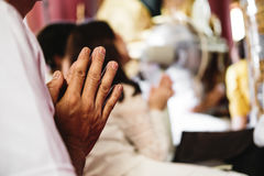 Elder hand pray obeisance in temple Royalty Free Stock Photos