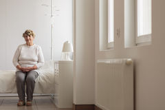 Elder lady in hospital room Royalty Free Stock Photos