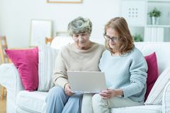 Elder lady and modern technology Royalty Free Stock Images