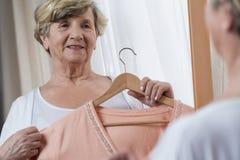Elder lady preparing for meeting. Happy elder lady preparing for important meeting Royalty Free Stock Photos