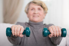 Elder lady training with dumbbells Stock Photography