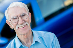 Elder man with a car Stock Images