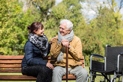 Elder man and carer stock image