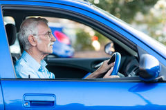 Elder man driving a car Stock Photography