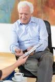 Elder man having business meeting Stock Photography