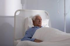Elder man in hospital Stock Photography