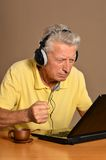 Elder man with laptop Stock Photo