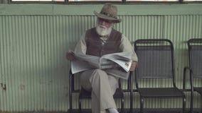 Elder Man With Newspaper stock video