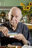 Elder Man with a Pill Case Stock Image