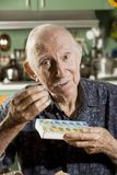 Elder Man with a Pill Case. Portrait of Elder Man Discussing Medications Royalty Free Stock Photos