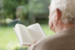 Elder man reading book Stock Photo
