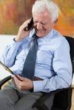 Elder man talking on phone Royalty Free Stock Photography