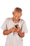 Elder man use smart phone Royalty Free Stock Photography