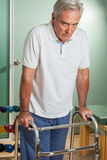 ELder man using a walker Stock Image