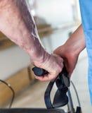 Elder man with walker. Detail on senior and nurse hands.  Stock Photos