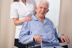 Elder man in a wheelchair Royalty Free Stock Image