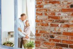 Elder man and woman hugging stock photos